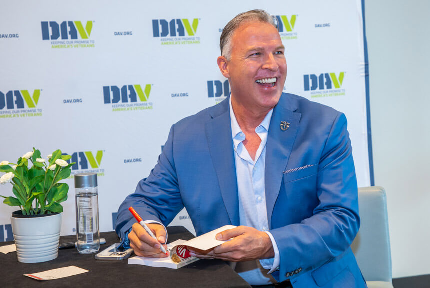 Larry Broughton signing VICTORY book at DAV